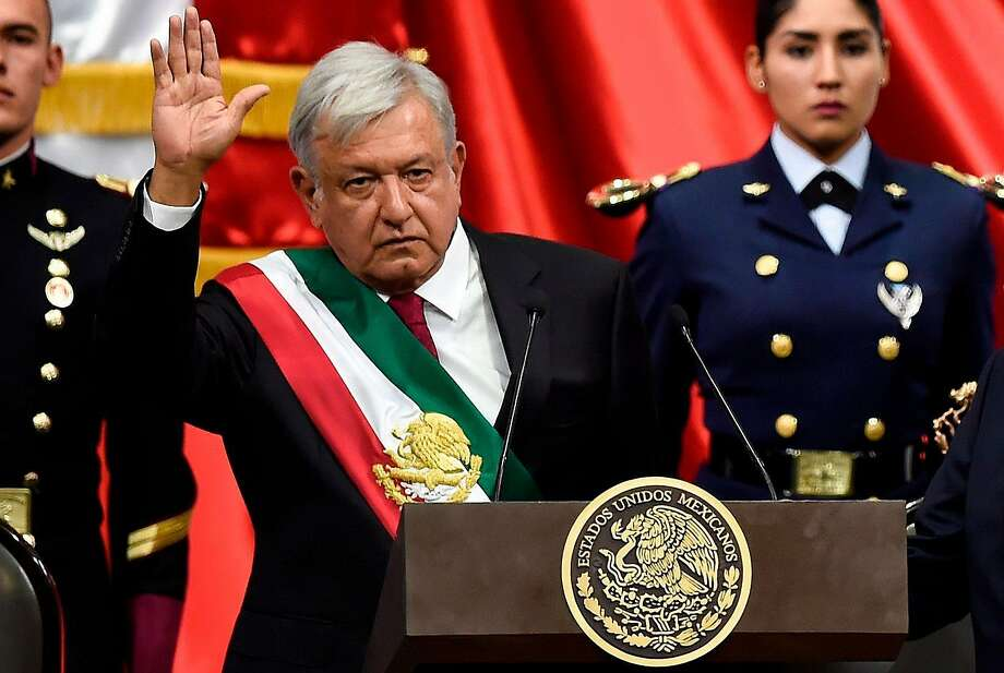 Andres Manuel Lopez Obrador, Mexico's new president, waves to members of Congress after receiving the presidential sash in Mexico City. He rose to prominence as a protest leader. Photo: Alfredo Estrella / AFP / Getty Images