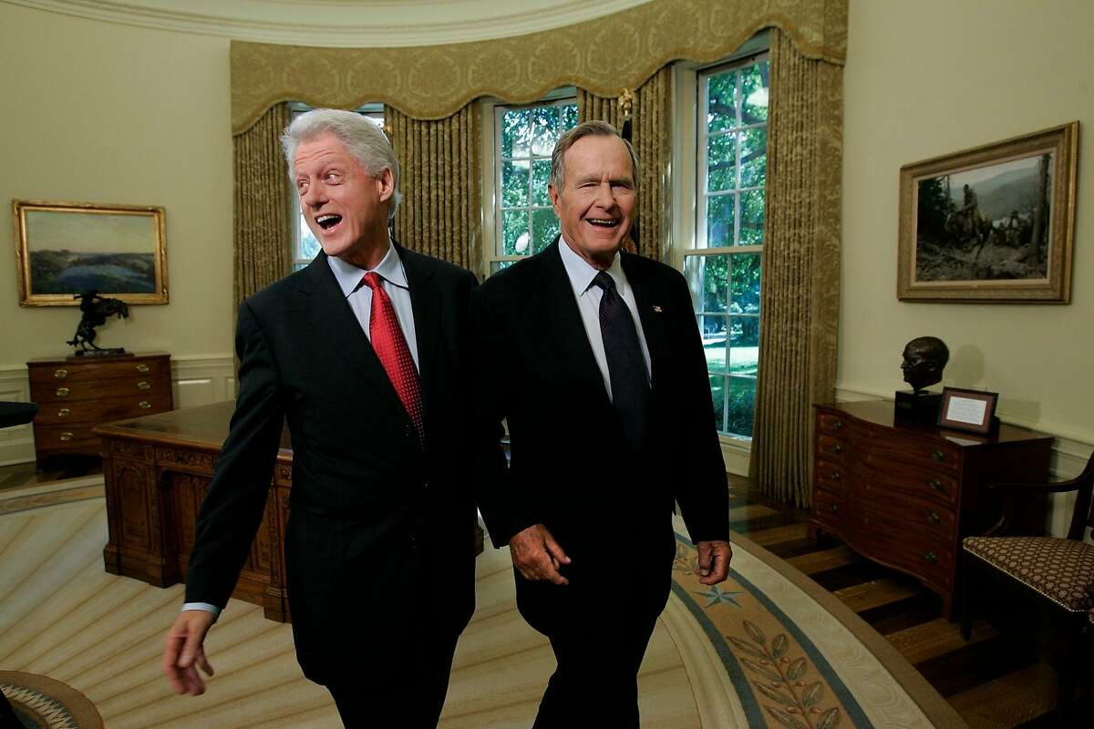 FILE -- Former Presidents Bill Clinton and George H.W. Bush in the Oval Office after a joint statement with President George W. Bush regarding Hurricane Katrina relief, in Washington, Sept. 1, 2005. Bush, the 41st president of the United States and the father of the 43rd, who steered the nation through a tumultuous period in world affairs but was denied a second term after support for his presidency collapsed under the weight of an economic downturn, died on Nov. 30, 2018. He was 94. (Doug Mills/The New York Times)