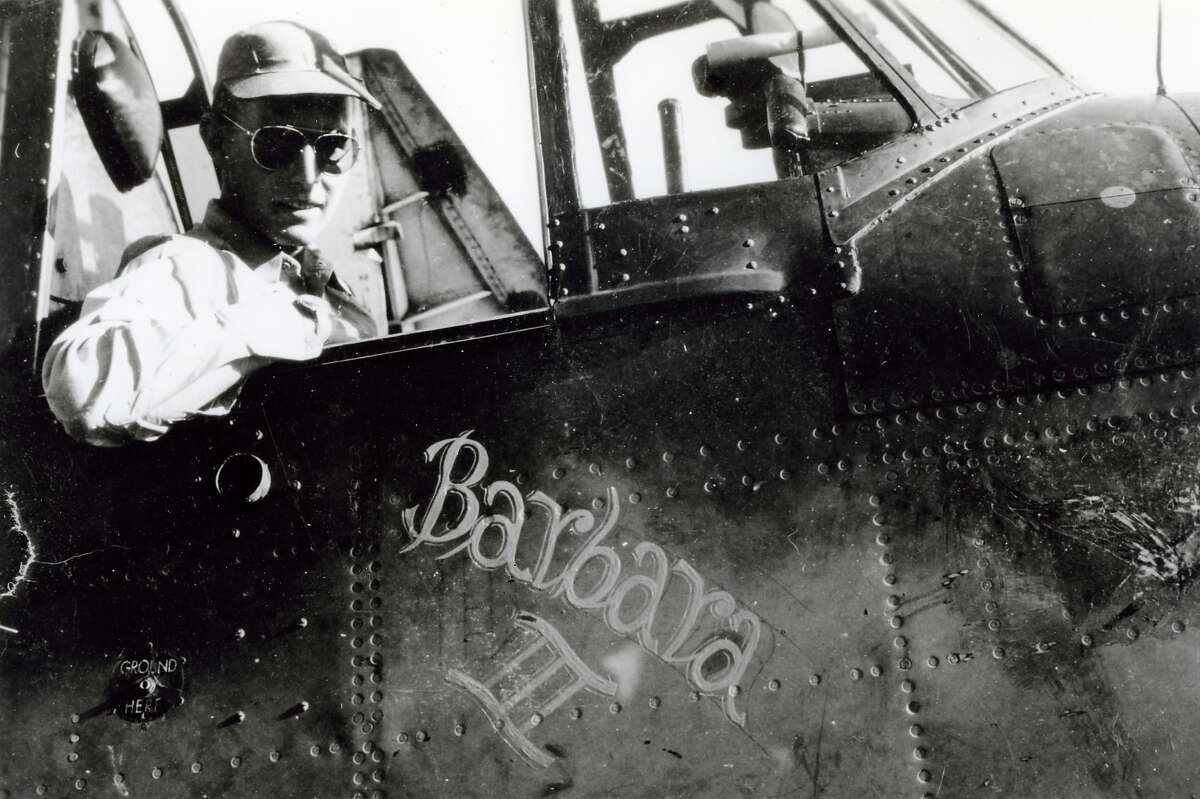 H67-01 George Bush, Navy Pilot, in the cockpit of his airplane, during World War II. circa 1943-44 Photo credit: George Bush Presidential Library and Museum