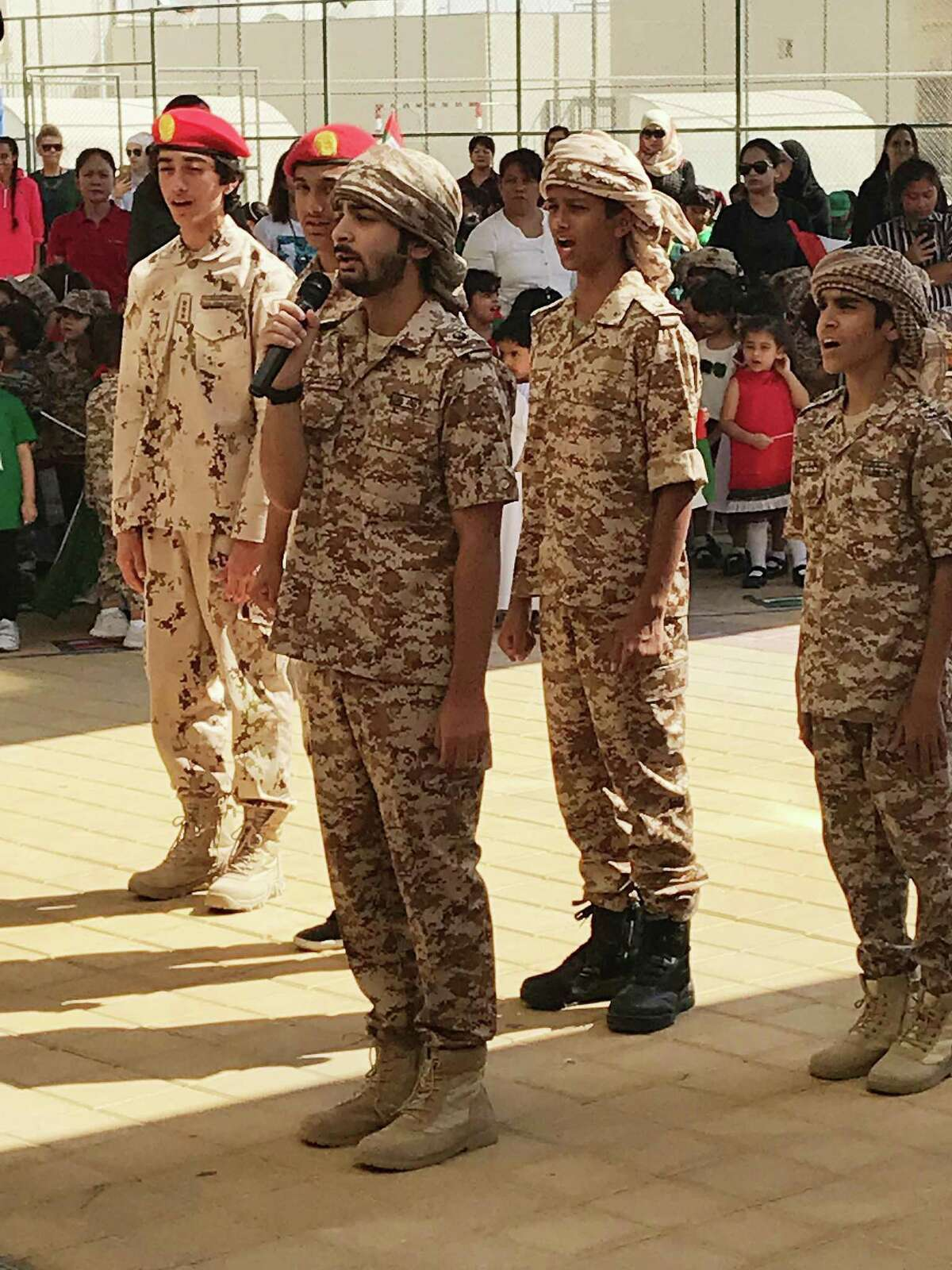 Ninth-grade boys at a school in the United Arab Emirates lead the singing of the national anthem before hoisting the flag -- something everyone was encouraged to do at precisely 11 a.m. on Nov. 1, Flag Day.