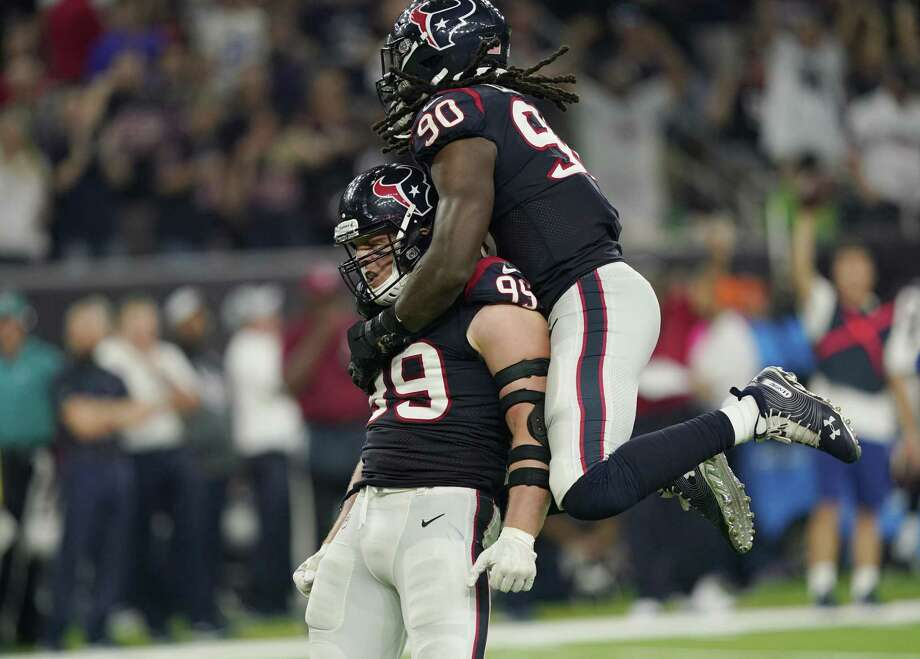 In this Oct. 7, 2018, file photo Houston Texans defensive end J.J. Watt (99) and linebacker Jadeveon Clowney (90) celebrate a stop against the Dallas Cowboys during the second half of an NFL football game in Houston. Photo: David J. Phillip, STF / Associated Press / Copyright 2018 The Associated Press. All rights reserved.