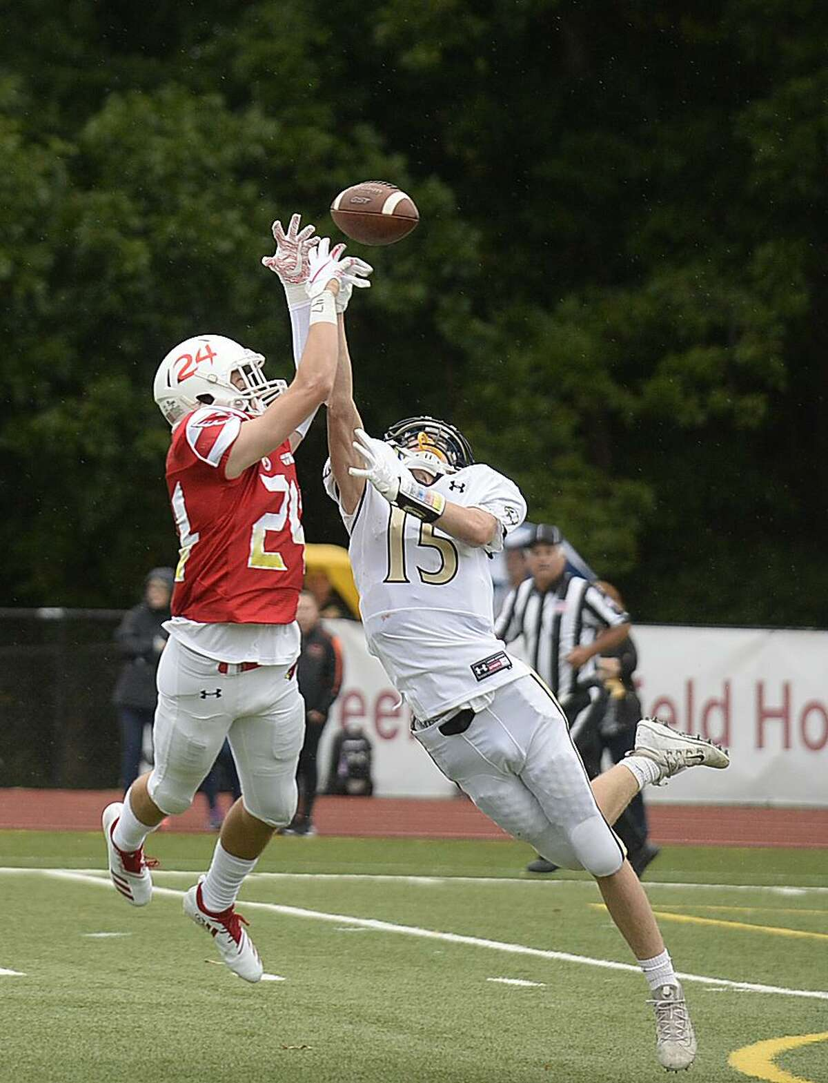 Greenwich's Nick Veronis blocks a pass intended for Trumbull's Kyle Atherton on Sept. 8.