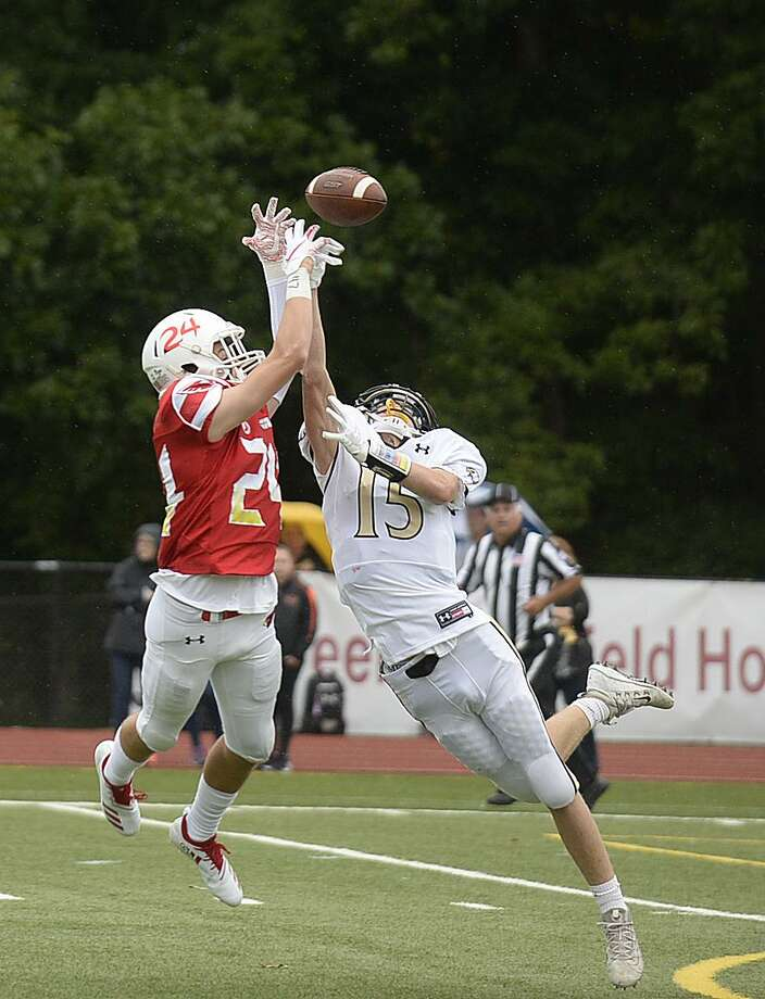 Greenwich's Nick Veronis blocks a pass intended for Trumbull's Kyle Atherton on Sept. 8. Photo: Lindsay Perry / For Hearst Connecticut Media / Greenwich Time Freelance