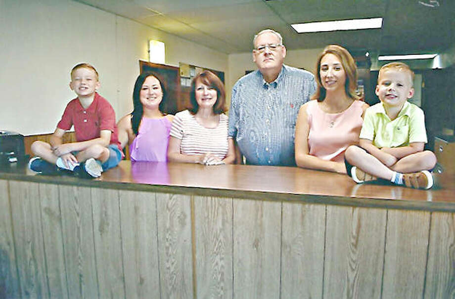 Walter Allen Hale III, center, and his family in the East Alton office. Photo: For The Telegraph
