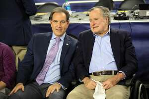HOUSTON, TEXAS - APRIL 02:  CBS broadcaster Jim Nantz (L) talks with former  President George H.W. Bush during halftime for the NCAA Men's Final Four Semifinal between the Villanova Wildcats and the Oklahoma Sooners at NRG Stadium on April 2, 2016 in Houston, Texas.  (Photo by Ronald Martinez/Getty Images)