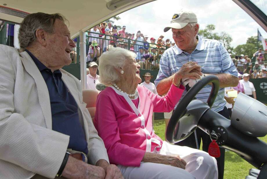 "FILE - Jack Nicklaus, right, visits with former First Lady Barbara Bush as former President George H.W. Bush looks on before the ""Greats of Golf"" section of the Insperity Invitational, May 2015 in The Woodlands. Photo: Jason Fochtman / Internal"