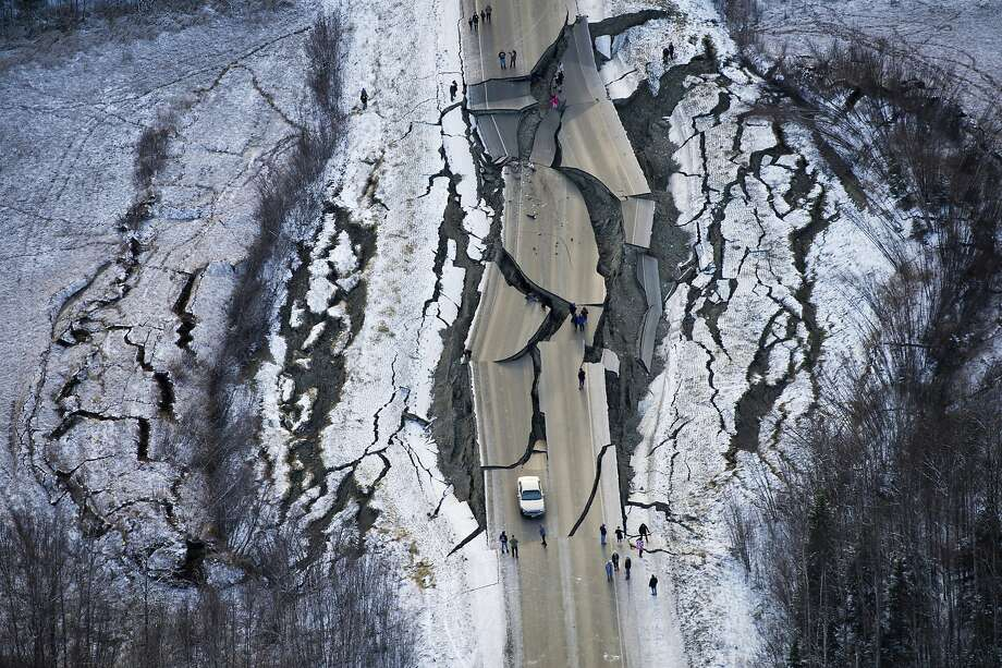 An aerial photo shows road damage near the town of Wasilla after back-to-back quakes measuring magnitude 7.0 and 5.7 struck the region Friday. Photo: Marc Lester / Anchorage Daily News