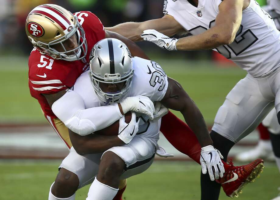 San Francisco 49ers linebacker Malcolm Smith (51) tackles Oakland Raiders running back Jalen Richard (30) during the first half of an NFL football game in Santa Clara, Calif., Thursday, Nov. 1, 2018. (AP Photo/Ben Margot) Photo: Ben Margot / Associated Press
