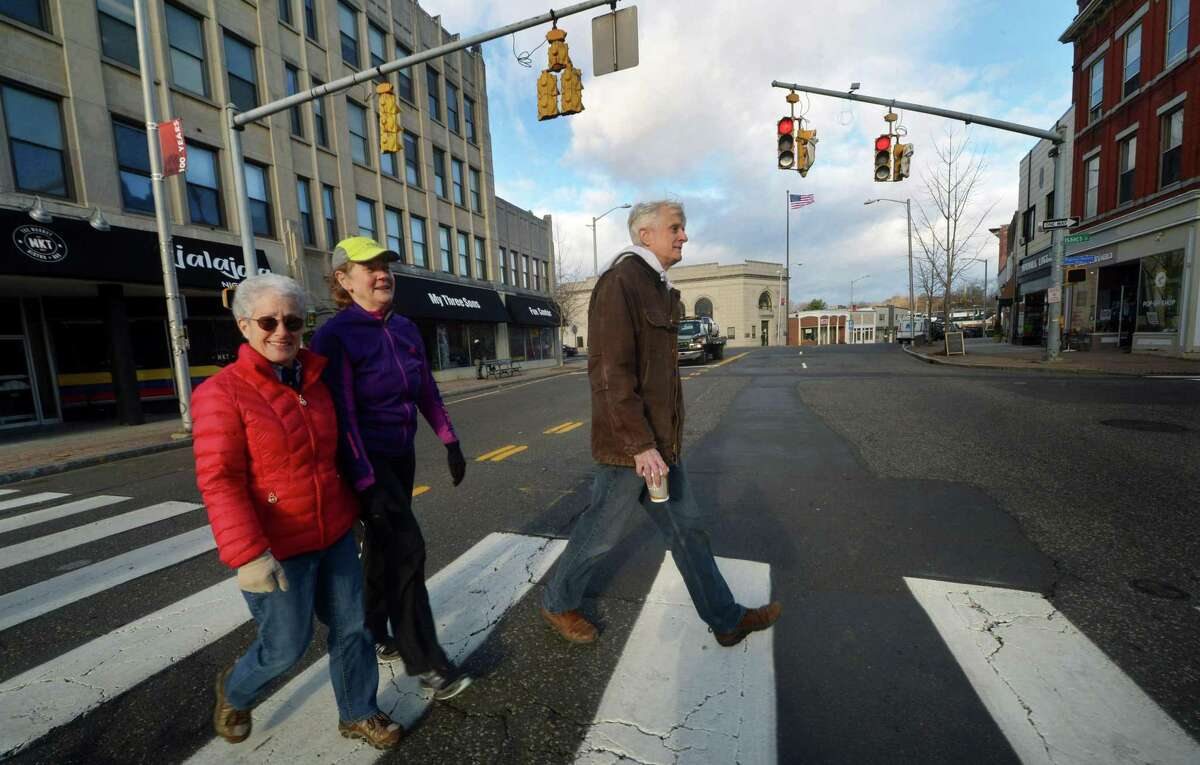 Norwalk Bike/Walk Commission Chairwoman Nancy Rosett and other crosswalk advocates from the Commission including Deborah Lewis and Jud Aley walk through the Wall Street district Wednesday, November 28, 2018, in Norwalk, Conn. The Commssion is looking to get more crosswalks approved and installed throughout the city. Such efforts require review by city and often state engineers, who consider accident histories, posted speed limits and sight lines.