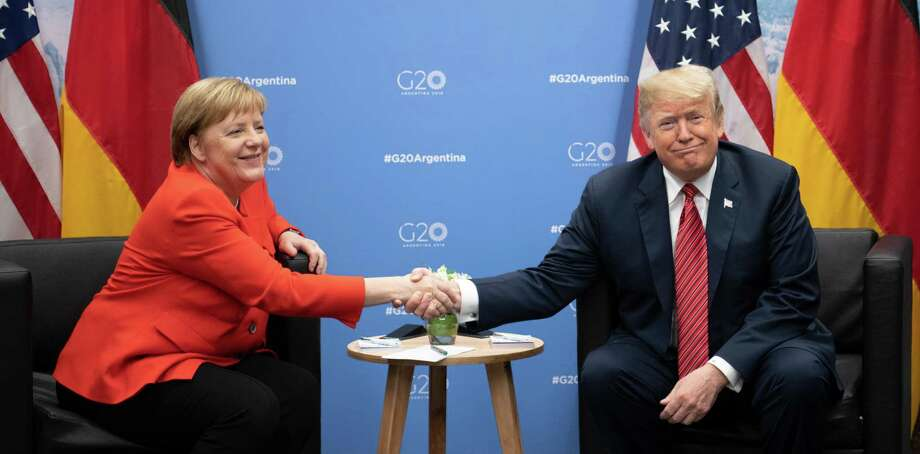 December 1, 2018 - Buenos Aires, Argentina - German Chancellor Angela Merkel, left, and U.S. President Donald Trump meet at the G20 Summit Meeting Centre on Dec. 1, 2018. President Trump canceled a scheduled news Saturday after the death of former President George H.W. Bush. (Ralf Hirschberger/DPA/Zuma Press/TNS) Photo: Ralf Hirschberger/DPA, MBR / TNS / Zuma Press
