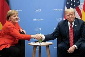 December 1, 2018 - Buenos Aires, Argentina - German Chancellor Angela Merkel, left, and U.S. President Donald Trump meet at the G20 Summit Meeting Centre on Dec. 1, 2018. President Trump canceled a scheduled news Saturday after the death of former President George H.W. Bush. (Ralf Hirschberger/DPA/Zuma Press/TNS)