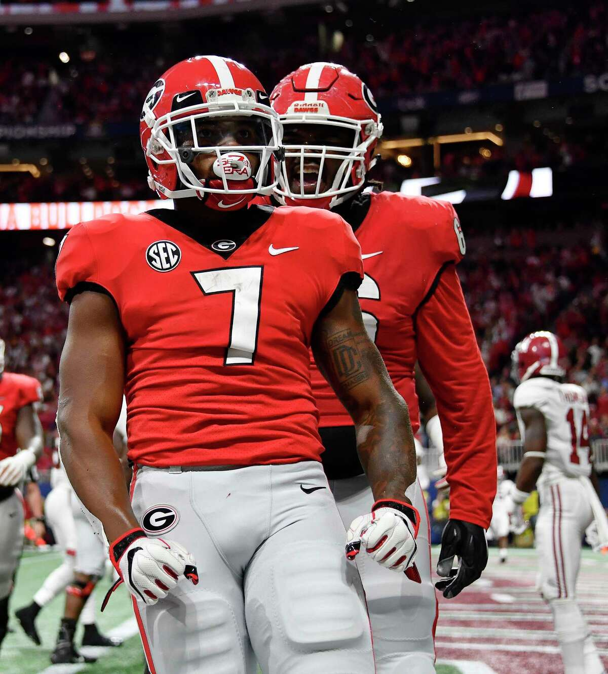 Georgia running back D'Andre Swift (7) celebrates his touchdown against Alabama during the first half of the Southeastern Conference championship NCAA college football game, Saturday, Dec. 1, 2018, in Atlanta.