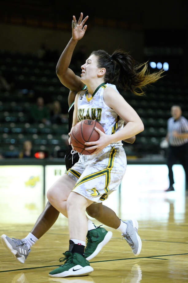 Midland College's Bethany Theodore (1) attempts to layup against Clarendon College's Mahogany Nails (15) and is sent to the line after the whistle, Dec. 1, 2018, at Chaparral Center. James Durbin/Reporter-Telegram Photo: James Durbin / ? 2018 Midland Reporter-Telegram. All Rights Reserved.