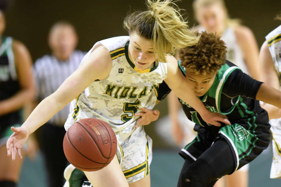 Midland College's Grace Beasley (5) goes after a loose ball against Clarendon College's Coretta Hopkins (11) Dec. 1, 2018, at Chaparral Center. James Durbin/Reporter-Telegram Photo: James Durbin / ? 2018 Midland Reporter-Telegram. All Rights Reserved.
