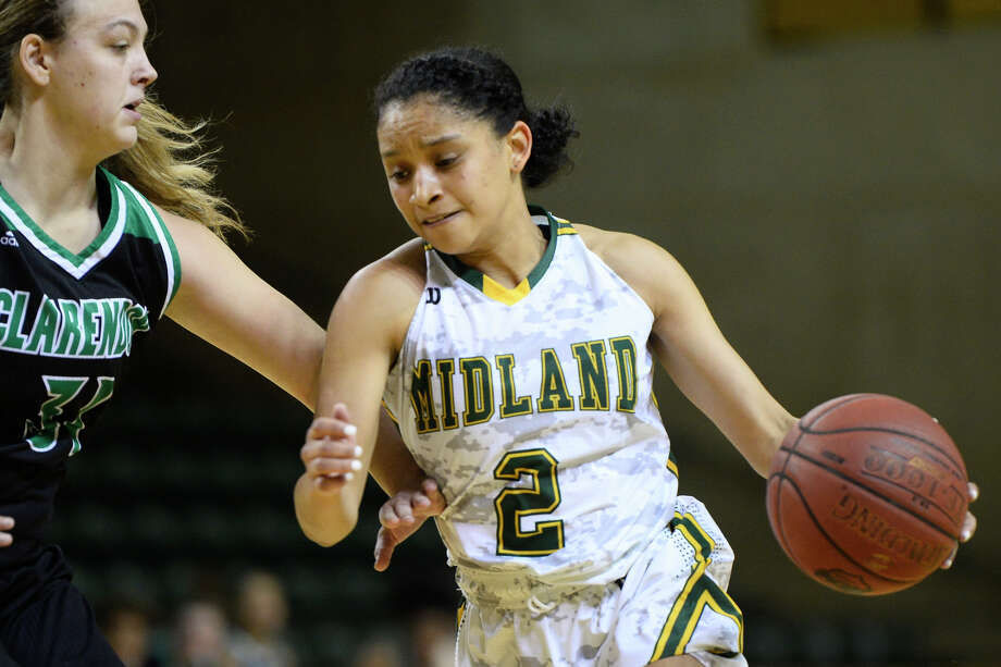 Midland College's Annilia Dawn (2) dribbles to the hoop while being guarded by Clarendon College's Kelzie Orr (31)  Dec. 1, 2018, at Chaparral Center. James Durbin/Reporter-Telegram Photo: James Durbin / ? 2018 Midland Reporter-Telegram. All Rights Reserved.