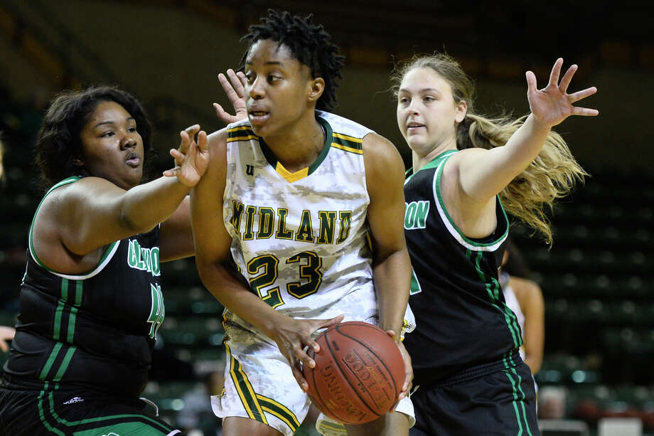 Midland College's Ogechi Nwodo (23) is guarded by Clarendon College's J'Kimbra Criss (44) and Kelzie Orr (31) Dec. 1, 2018, at Chaparral Center. James Durbin/Reporter-Telegram Photo: James Durbin / ? 2018 Midland Reporter-Telegram. All Rights Reserved.