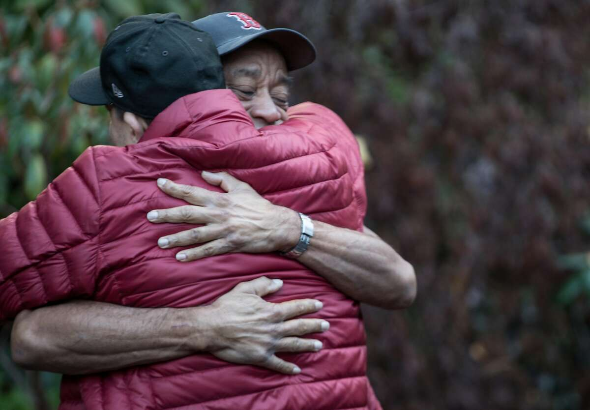 Russ Smith (right) and Jake Tapia embrace during an observance of World Aids Day held at the National Aids Memorial Grove at Golden Gate Park in San Francisco, Calif. Saturday, Dec. 1, 2018.
