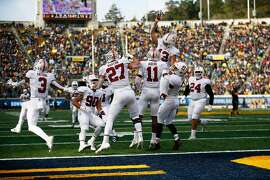 The Stanford Cardinal celebrate the interception during the second half of the 121st Big Game at Memorial Stadium on Saturday, Dec. 1, 2018, in Berkeley, Calif.