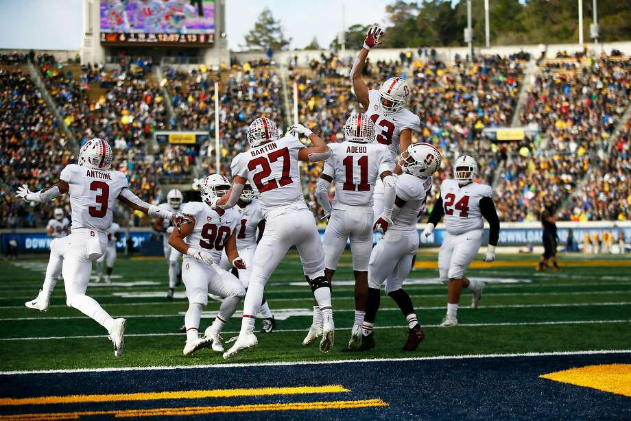 Stanford teammates swarm Paulson Adebo after his interception. Adebo had two picks Saturday as Stanford's defense throttled Cal and led the way to a 23-13 victory, the Cardinal's ninth straight Big Game win. Photo: Santiago Mejia / The Chronicle