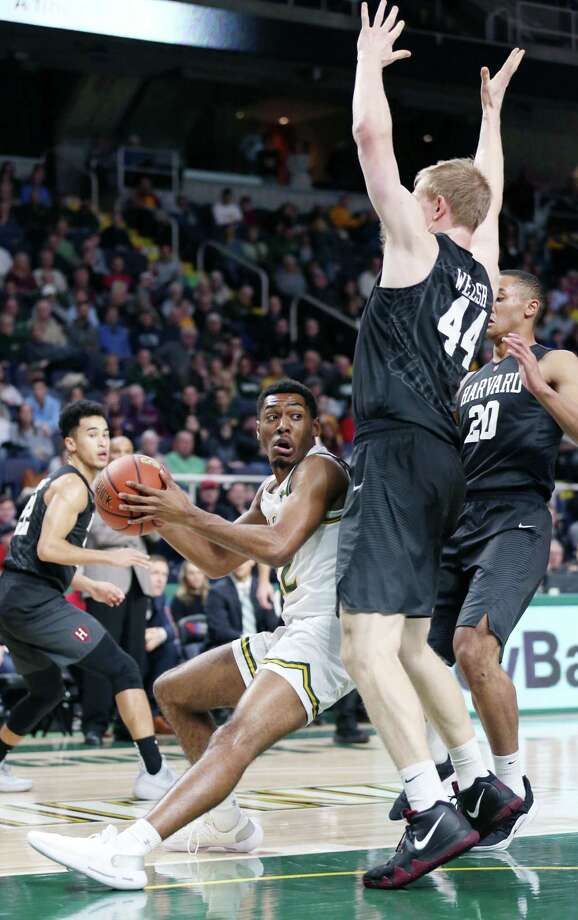 Siena guard Jalen Pickett collides with Harvard forward Henry Welsh during a game Saturday Dec. 1, 2018 at the Times Union Center. (Phoebe Sheehan/Special to the Times Union) Photo: Phoebe Sheehan