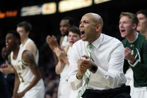 Siena men's basketball head coach Jamion Christian reacts after a play during a game against Harvard Saturday Dec. 1, 2018 at the Times Union Center. (Phoebe Sheehan/Special to the Times Union)