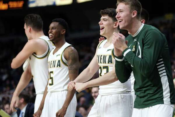 Siena men's basketball players react after the team scores during a game against Harvard Saturday Dec. 1, 2018 at the Times Union Center. (Phoebe Sheehan/Special to the Times Union)
