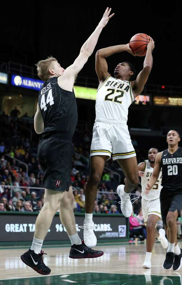Siena guard Jalen Pickett jumps up toward the net during a game against Harvard Saturday Dec. 1, 2018 at the Times Union Center. (Phoebe Sheehan/Special to the Times Union) Photo: Phoebe Sheehan