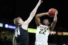 Siena guard Jalen Pickett jumps up toward the net during a game against Harvard Saturday Dec. 1, 2018 at the Times Union Center. (Phoebe Sheehan/Special to the Times Union)