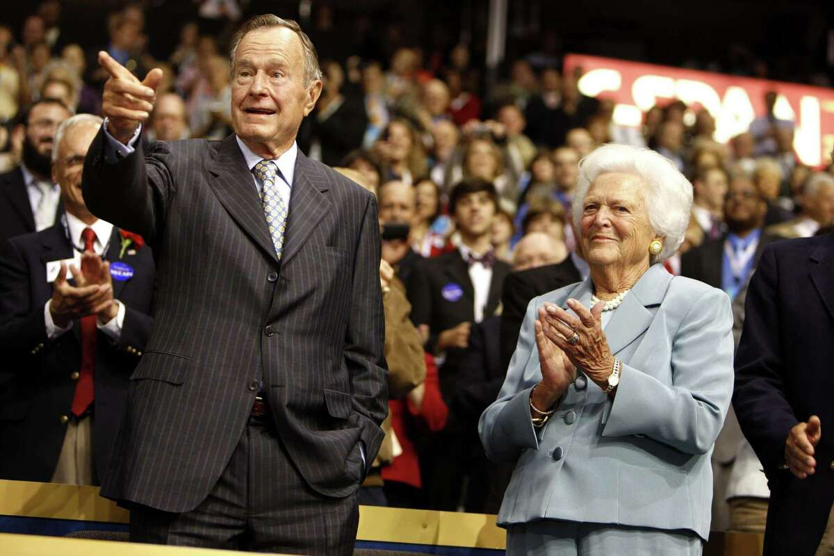 FILE: Former U.S. President George H.W. Bush, left, and his wife Barbara, acknowledge the audience on day two of the Republican National Convention (RNC) at the Xcel Energy Center in St. Paul, Minnesota, U.S., on Tuesday, Sept. 2, 2008. George H.W. Bush, the U.S. president who fashioned a restrained response to the Soviet Union?'s collapse and assembled the multinational coalition that liberated Kuwait from an Iraqi invasion, hoping that would be a model for ?