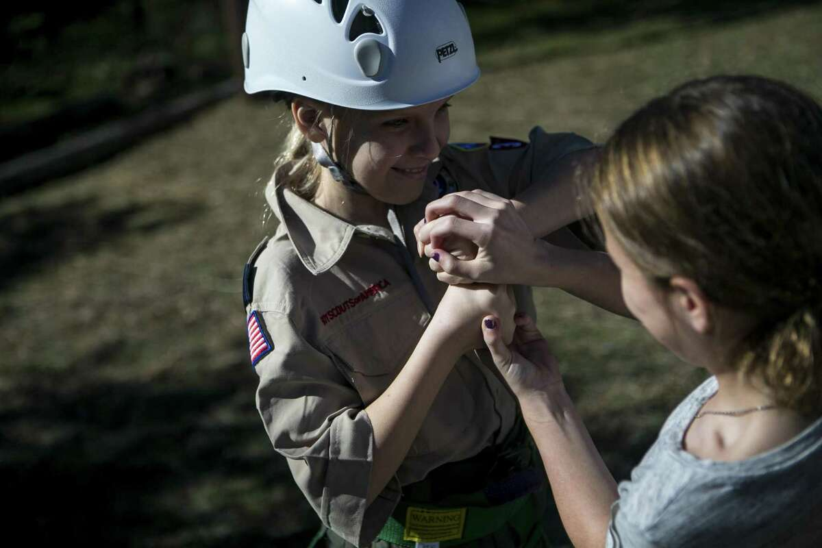 Katie Powell, 10, plays a game with Hailey Bowen, 11, as they wait their turn for climbing at McGimsey Scout Park during a training weekend for Scouts BSA, a new Scouts BSA program, which will launch in February 2019 featuring troops with all girls, on Dec. 1, 2018.