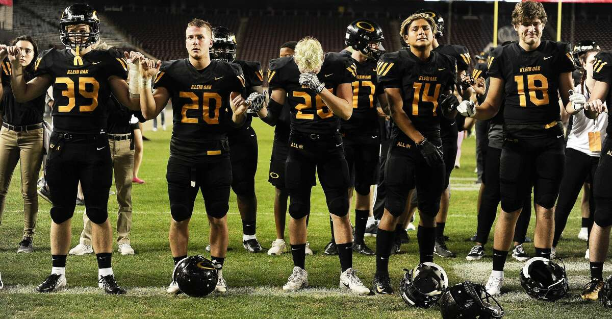 Klein Oak's (left to right) Andy Wilson, Nathan Herrscher, Cullen Marmor, Freddie Gutierez, and Dawson Miller stand for the school song after the team's loss to Midway in a 6A Div. I semi-final high school football playoff game, Saturday, Dec. 1, 2018, in College Station, TX. (Eric Christian Smith/Contributor