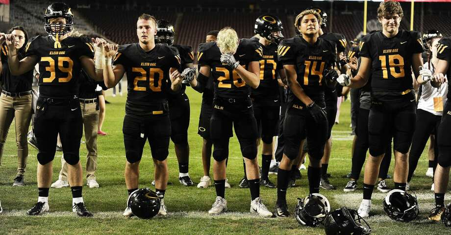 Klein Oak's (left to right) Andy Wilson, Nathan Herrscher, Cullen Marmor, Freddie Gutierez, and Dawson Miller stand for the school song after the team's loss to Midway in a 6A Div. I semi-final high school football playoff game, Saturday, Dec. 1, 2018, in College Station, TX. (Eric Christian Smith/Contributor Photo: Eric Christian Smith/Contributor