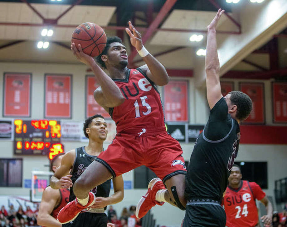 SIUE's David McFarland (15) shoots over SIUC's Marcus Bartley for two of his career-high 24 points in the Cougars' loss Saturday afternoon at Vadalabene Center in Edwardsville. Photo: Scott Kane / SIUE Athletics