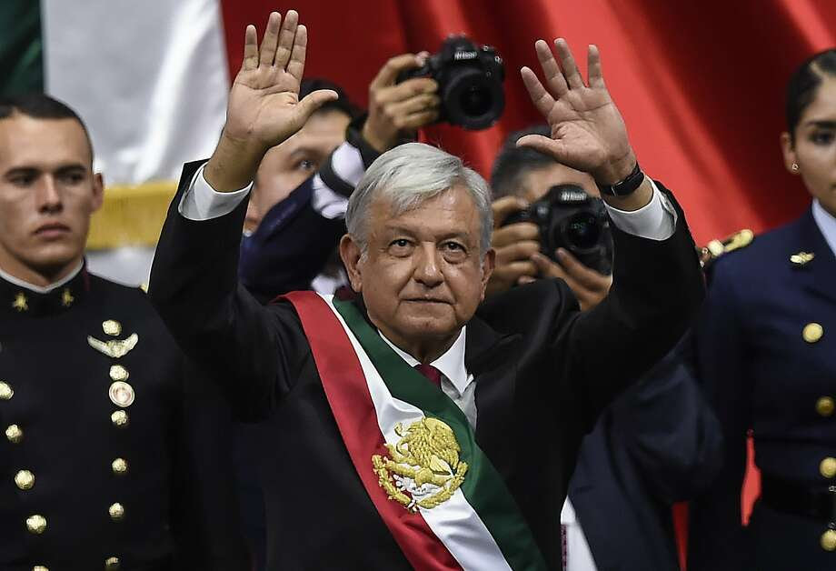 Mexico's new President Andres Manuel Lopez Obrador waves after being sworn-in, at the Congress of the Union, in Mexico City on December 1, 2018. - Lopez Obrador, 65, won Mexico's July 1 election in a landslide, and euphoric supporters are full of hope that the fiery populist will bring sweeping change, slash poverty and fight endemic corruption. (Photo by Alfredo ESTRELLA / AFP)ALFREDO ESTRELLA/AFP/Getty Images Photo: ALFREDO ESTRELLA, AFP/Getty Images