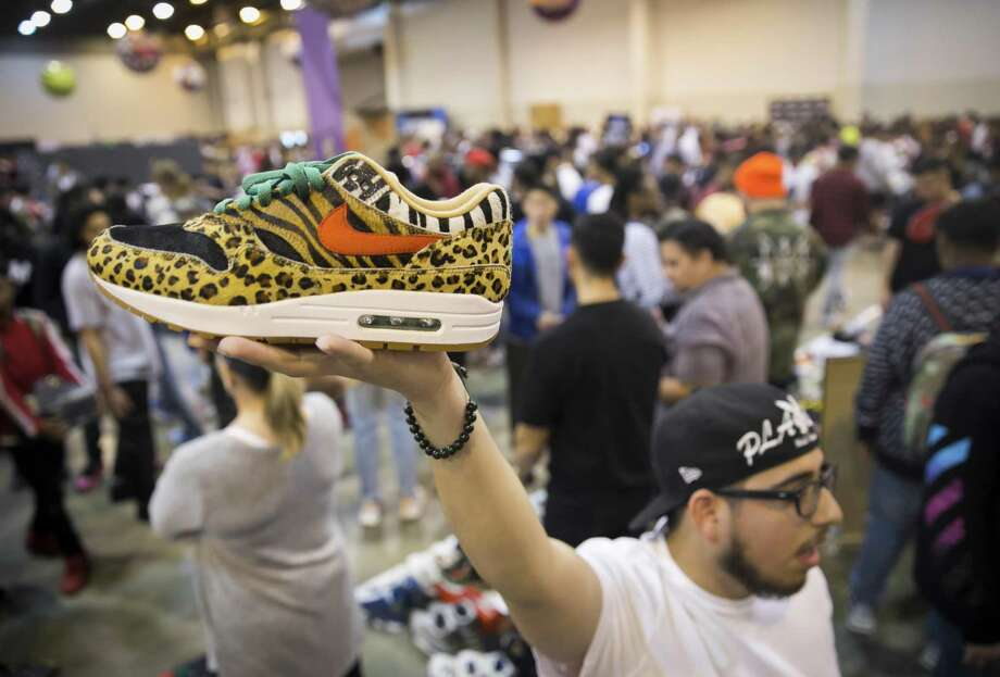 f48288be6c39 Rodrigo Ojeda holds up a pair of Nike Safari Air Max shoes during Sneaker  Con at