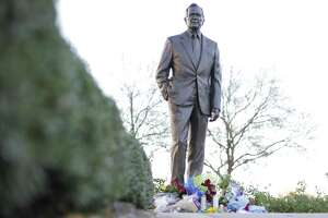 A statue of George H.W. Bush by artist Chas Fagan outside Bush's library and museum at College Station, Texas on Saturday, Dec. 1, 2018.