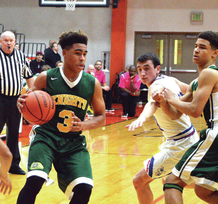 Metro-East Lutheran senior Jason Williams, left, drives to the basket during the second quarter of Saturday's game against Nashville in the Scott Credit Union Shootout at Edwardsville High School. Photo: Scott Marion/Intelligencer