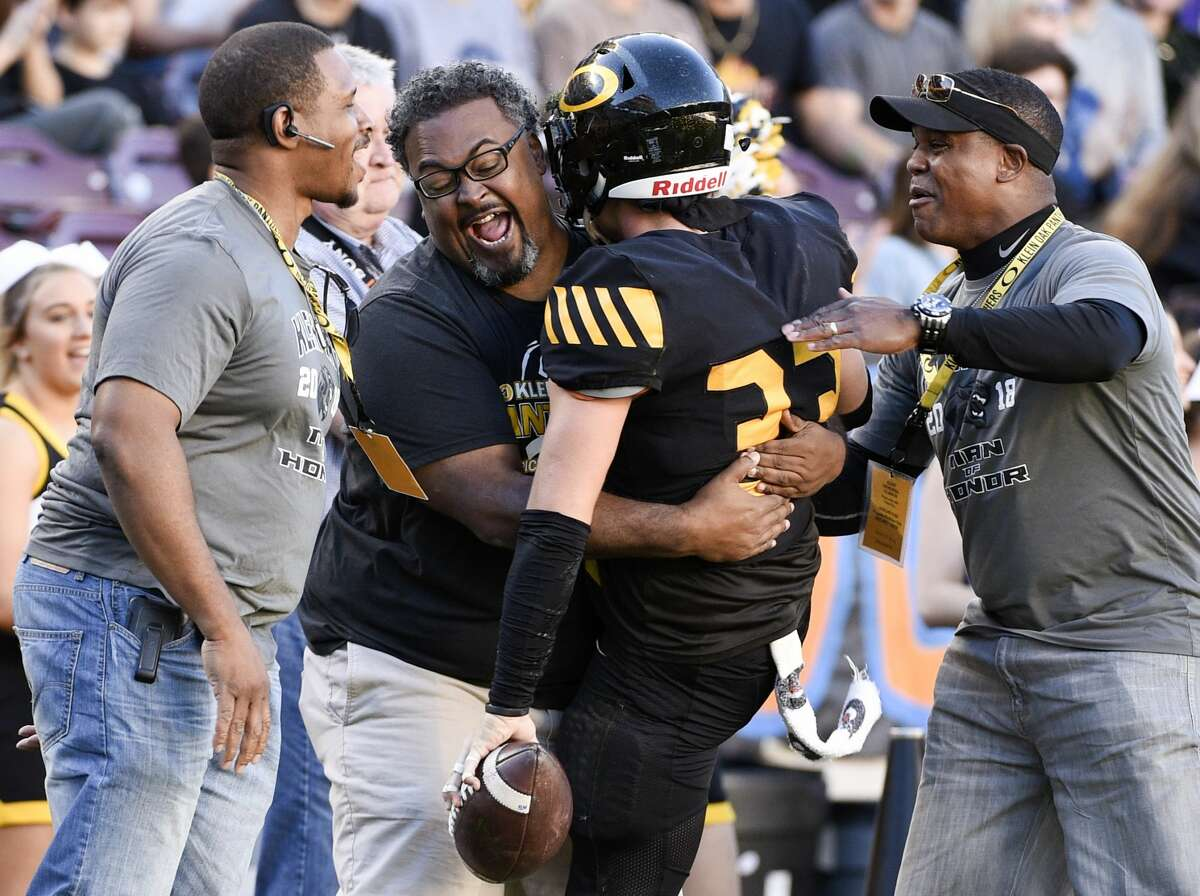 Klein Oak linebacker A.J. Roberts (33) celebrates his fumble recovery with fans on the sidelines during the first half of a 6A Div. I semi-final high school football playoff game against Midway, Saturday, Dec. 1, 2018, in College Station, TX. (Eric Christian Smith/Contributor