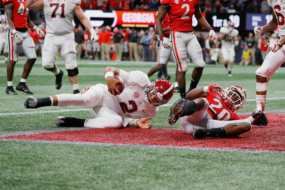 Alabama quarterback Jalen Hurts, who came in when starter Tua Tagovailoa was injured, rushes for a 15-yard touchdown in the fourth quarter against Georgia in the SEC title game. Photo: Kevin C. Cox / Getty Images