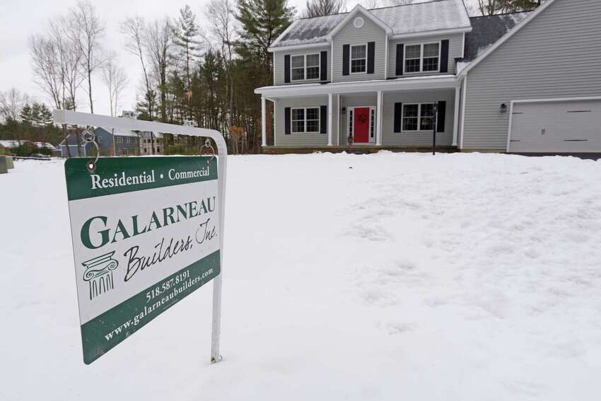 A sign for Galarneau Builders is seen in the front yard of the home of Chris and Sarah Landers on Cardiff Circle on Wednesday, Nov. 21, 2018, in Wilton, N.Y. Galarneau Builders stepped in and worked with the Landers to get their home finished quickly and within their budget after they ran into major problems with the first builder they hired. (Paul Buckowski/Times Union)