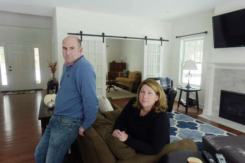 Chris and Sarah Landers pose for a photo inside their home on Cardiff Circle on Wednesday, Nov. 21, 2018, in Wilton, N.Y. The Landers are finally in their new home after running into major problems with the first builder they hired. The process to get the house finished took two and a half years. (Paul Buckowski/Times Union)