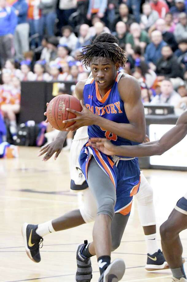 Danbury's Denali Burton drives to the basket during the Division I boys basketball quarterfinals between Danbury and Notre Dame-Fairfield at Trumbull High on March 12. Danbury faces Abbott Tech on Thursday, Dec. 13 at 6 p.m. in the 19th Annual News-Times Greater Danbury Boys Tip-Off Classic at Immaculate High. Photo: Krista Benson / For Hearst Connecticut Media / The News-Times Freelance