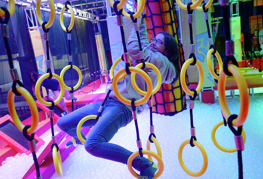 Josie Davis makes her way through a challenge course on the opening day of Urban Air, an adventure and trampoline park, in Beaumont Saturday. Photo taken Saturday, December 1, 2018 Kim Brent/The Enterprise Photo: Kim Brent/The Enterprise