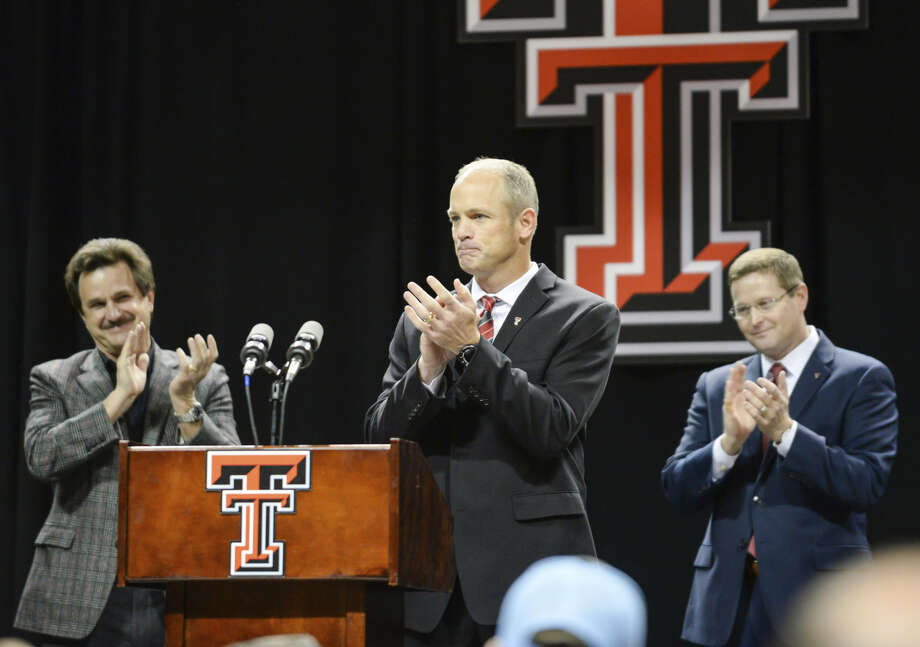 Texas Tech's new head football coach Matt Wells, center receives a standing ovation from Kirby Hocutt, Lawrence Schovanec and the crowd during the introductory news conference Saturday, Dec. 1, 2018, in Lubbock. Photo: Abbie Burnett/Lubbock Avalanche-Journal Via AP