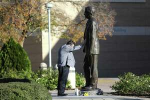 """Brian Blake, a former director of communications at the George H.W. Bush Library and Museum, pauses in front of a statue of the former president at the College Station landmark on Saturday, Dec. 1, 2018. """"I need to be here,"""" Blake said, who worked from 1997-2009 at the library. """"He and Barbara were the most amazingly gracious people on the planet. I never felt like I was working for them, just always working with them."""""""