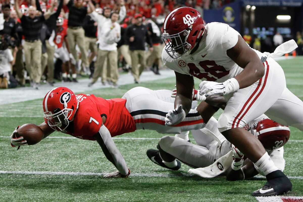 Georgia running back D'Andre Swift (7) drives in for a touchdown against Alabama during the first half of an NCAA college football game for the Southeastern Conference championship Saturday, Dec. 1, 2018, in Atlanta. (Joshua L. Jones/Athens Banner-Herald via AP)