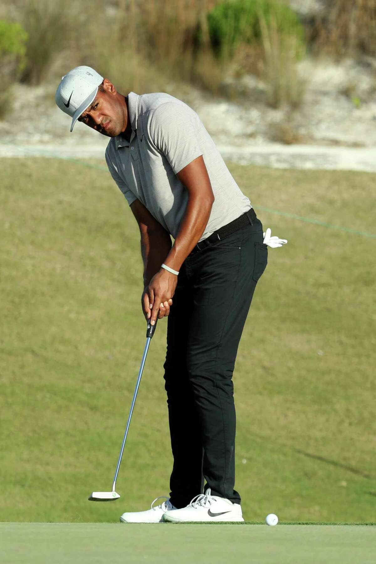 NASSAU, BAHAMAS - DECEMBER 01: Tony Finau of the United States putts on the 16th green during round three of the Hero World Challenge at Albany, Bahamas on December 01, 2018 in Nassau, Bahamas. (Photo by Rob Carr/Getty Images)