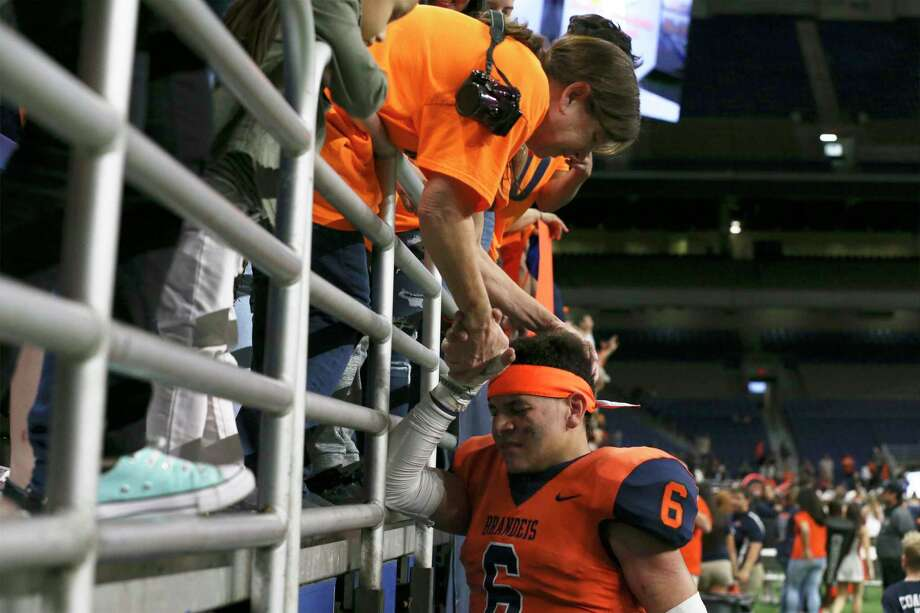 Kay Mitchell congratulates her grandson after the helped lead the Broncos in a comeback victory against Brownsville Hanna in playoff game at the Alamodome. Photo: Kin Man Hui / ©2018 San Antonio Express-News
