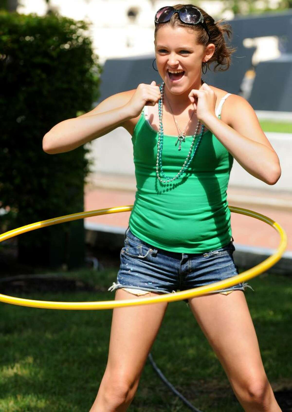 """Erika Cardin, of Albany, gets her groove on as she competes in the Disney sponsored """"Hula Hoop Contest"""" at GE's Kids Day on Sunday, July 18, 2010, at the Empire State Plaza in Albany, NY. The General Electric sponsored event treated children to bouncy bounce setups, food, a petting zoo, pony rides, crafts, characters to meet and face painting for the day. Luanne M. Ferris / Times Union"""