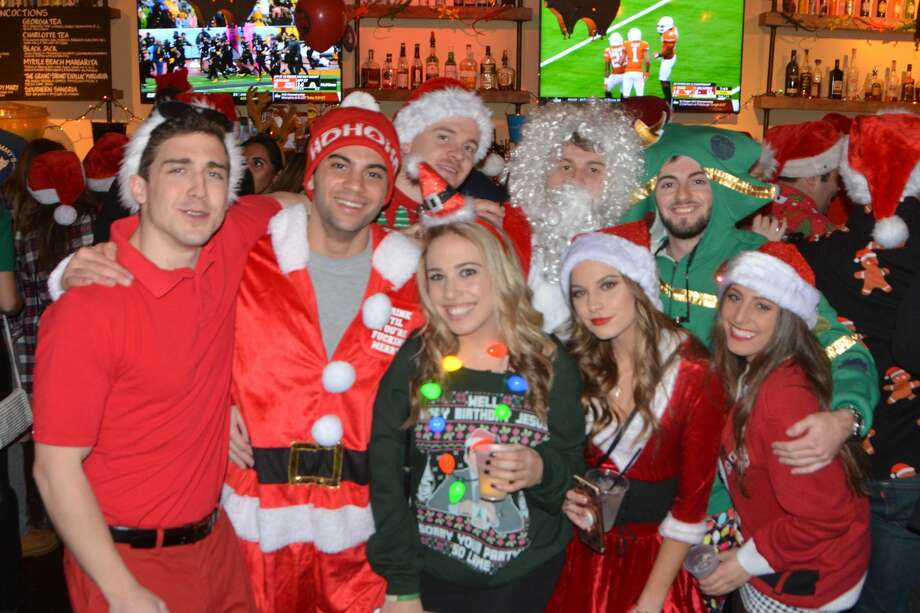 Santas will swarm the streets of Stamford during the annual SantaCon bar crawl on Saturday. Find out more. Photo: Vic Eng / Hearst Connecticut Media Group